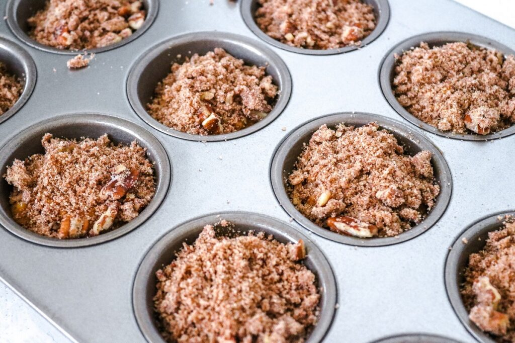 Keto Cream Cheese Muffins with Pecans in muffin tin