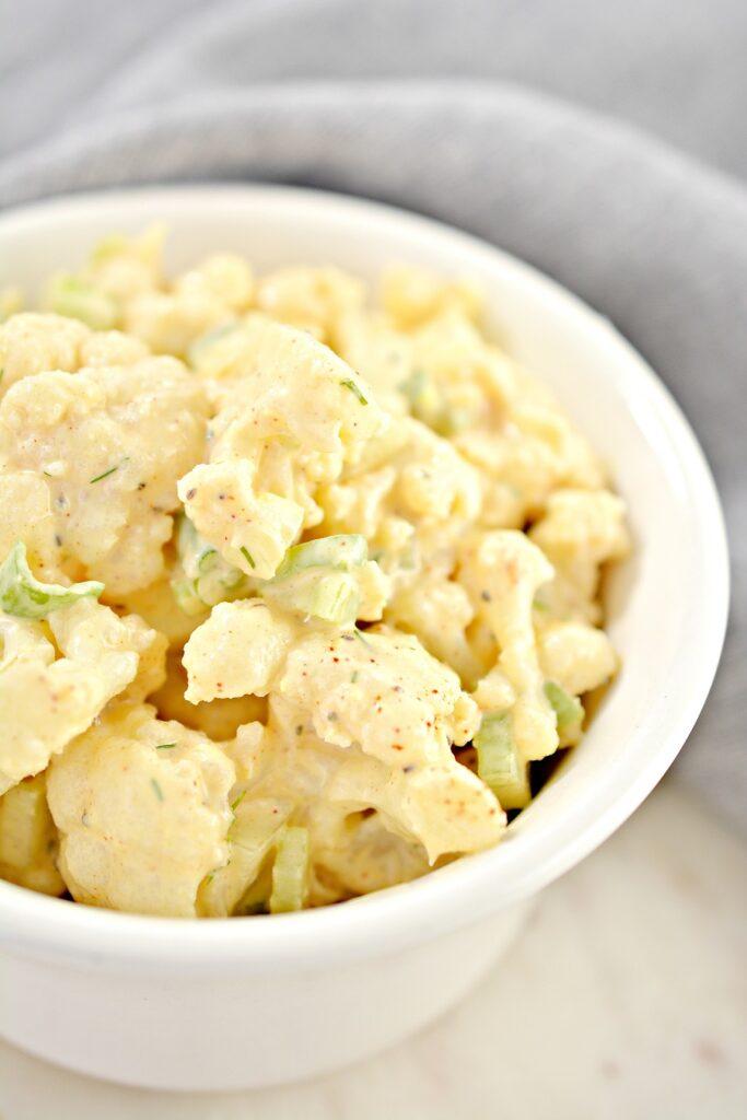 Cauliflower Potato Salad in white bowl