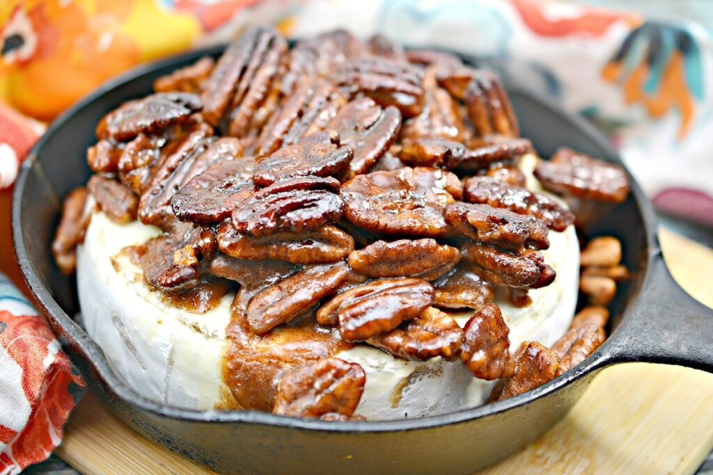 Keto Baked Brie With Pecans in pan
