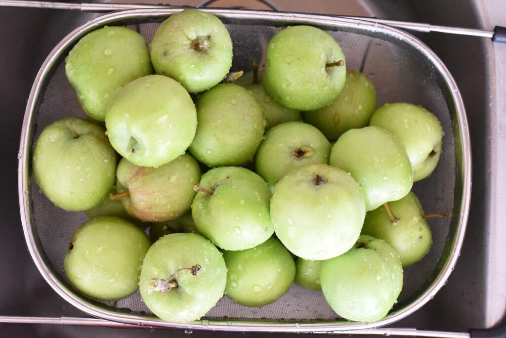 Green Apples in sink