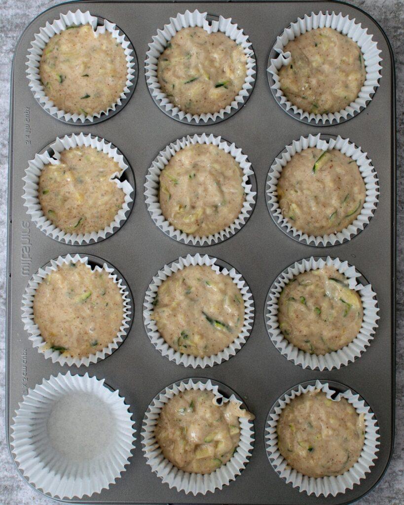 Vegan Zucchini Muffins in muffin tins