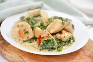 Keto Creamy Chicken with Sage and Spinach on white plate