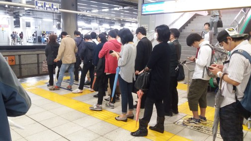 Silent queuing on the subway. Marvellous.