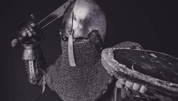 Medieval Soldier in armour with sword and shield