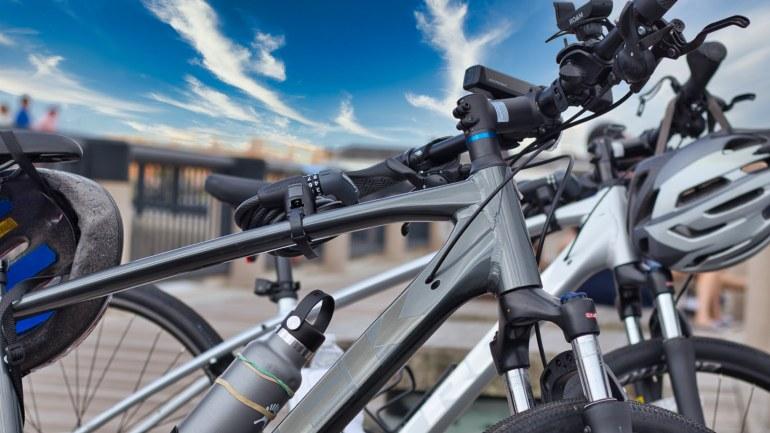 Bikes parked at a bridge.