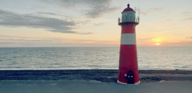 lighthouse in calm sea