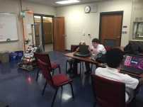 Members of Programming working on last years robot