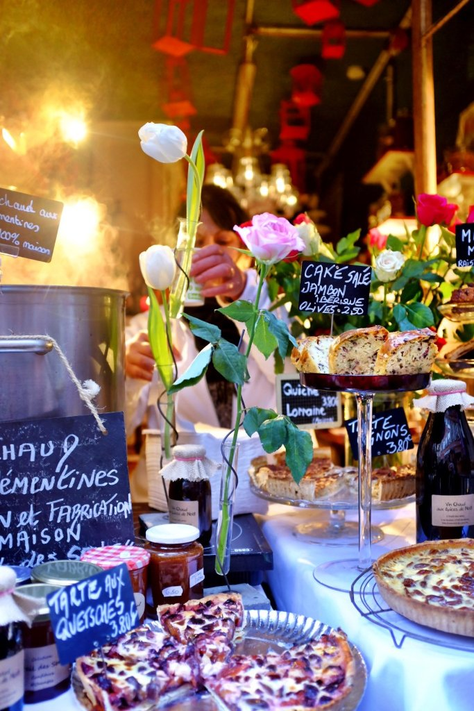 Cute little window shop where you can buy mulled wine and traditional French sweets. Very romantic approach with roses and other flowers.Seen while we were at the Christmas Markets in Strasbourg.