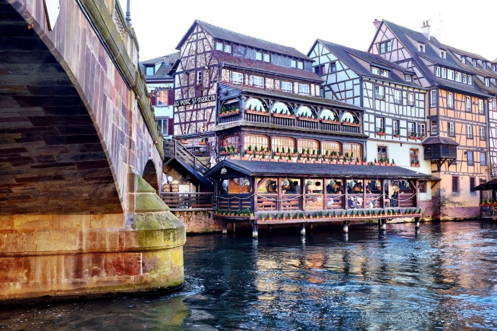 Medieval building in Strasbourg, built at the river Ill. Used as a restaurant. On the left side of the picture is a bridge