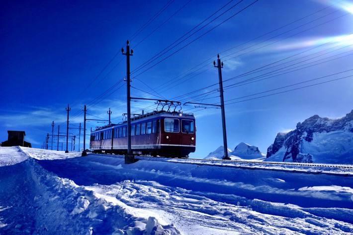 The Gornergrat cog railway in a snowy landscape near Zermatt