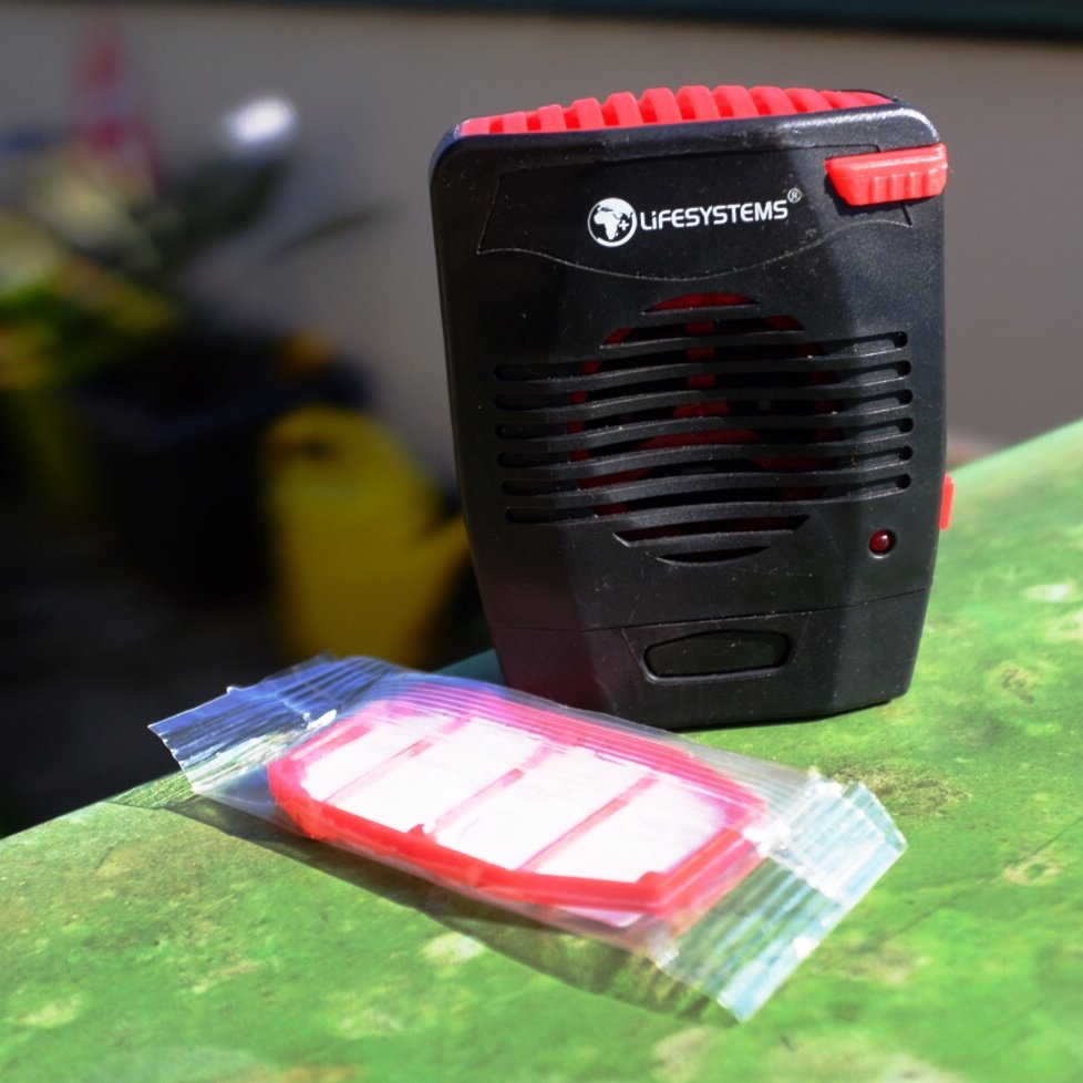 A black and red Lifesystems insect repellent vaporizer with a refill pack. Actually kills Mosquitos