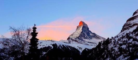 The Matterhorn in the red light of the sunrise in Zermatt