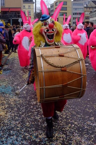 Clown with drums at the Basler Fasnacht