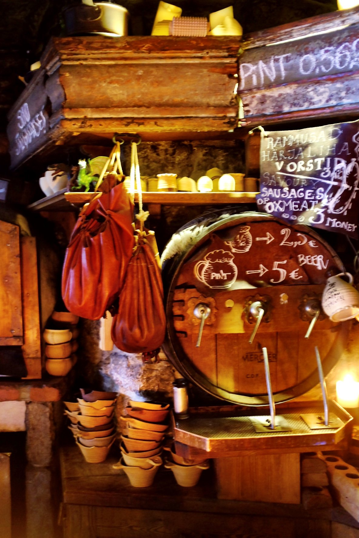 The Draakon interieur with a barrel, some ceramic bowls, some bags and the menu written all over the place. Situated in Tallinn