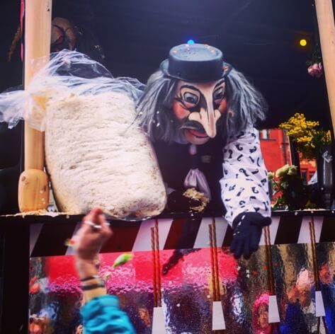 Masked man with a bag of confetti to throw on the crowd at Basel Fasnacht