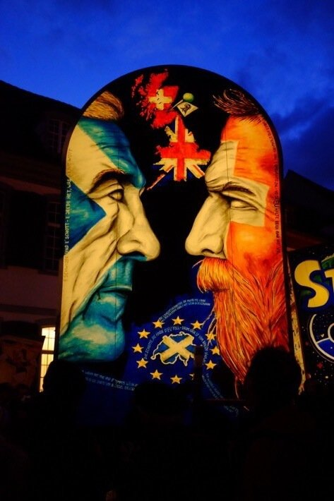 Lantern at Basel Fasnacht depicting a political point about the similarities of Scotland and Switzerland