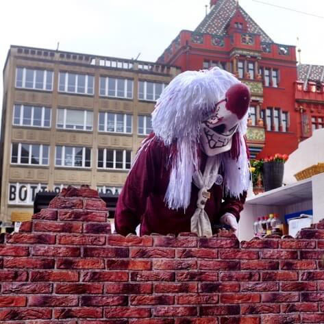 A Waggis looks over the wall of his truck at the Basel Fasnacht