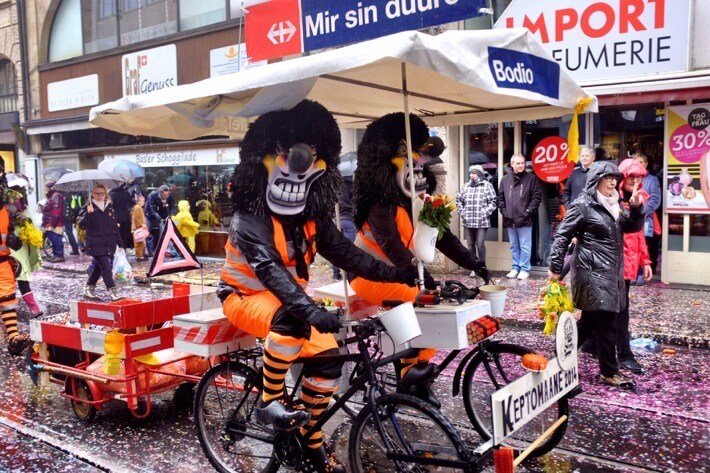 Costumed Waggis on bikes at the Basel Fasnacht cortege
