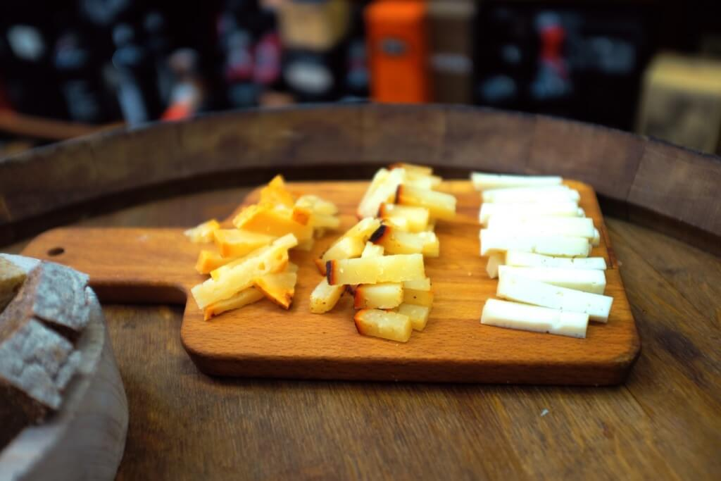 Foodie highlights of Porto cheese on a wooden plate