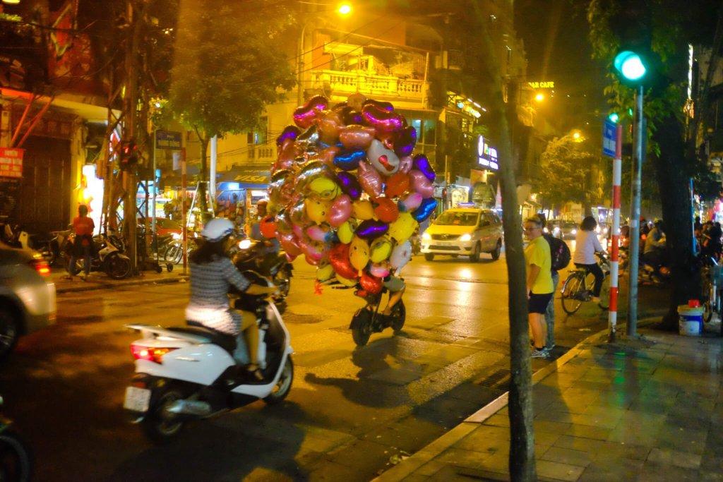 Food in Hanoi Old Quarter busy street night