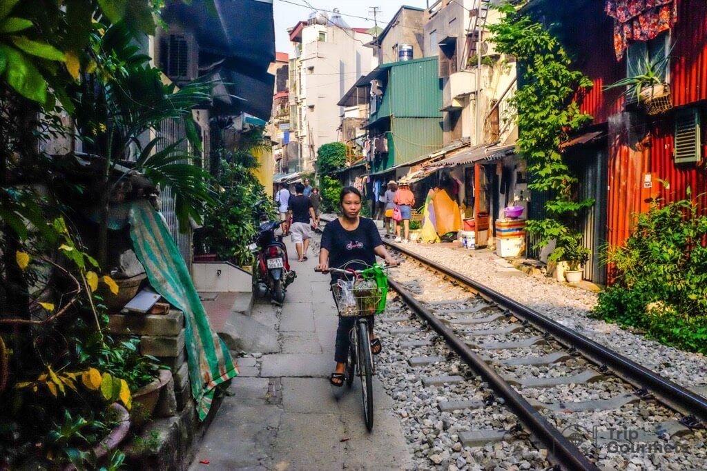 Girl on bike in the Hanoi train street
