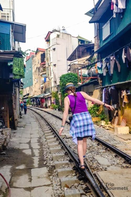 Hanoi Train Street balancing on the rails