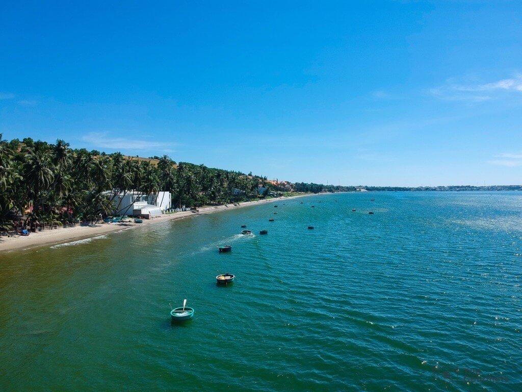 Things to do in Mui Ne Muine beach boats palms sea drone footage
