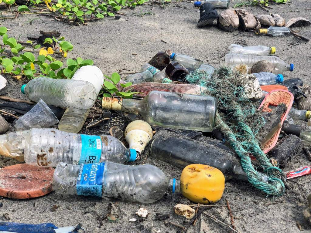Water purifier for travel: Plastic bottles on the beach