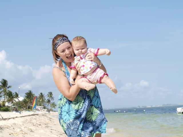 Girl with baby on beach
