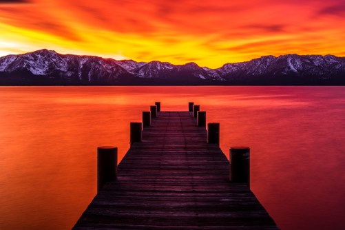 The tangerine sunset over Lake Tahoe is an advantage of moving to Nevada