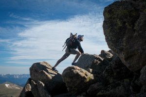 a man hiking on the rocks