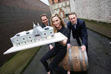 *** NO REPRODUCTION FEE *** 29/01/2014 : Reviving the Spirit of Dublin - €10m Investment to create over 30 new jobs in Dublin's Liberties. Teeling Whiskey Company announces plans for new Dublin whiskey distillery. Visitor Centre to attract 100,000 visitors per annum. Pictured at the new Teeling Whiskey Company (TWC) whiskey distillery announcement was model Sarah Morrissey with Stephen Teeling, Sales and Marketing Director and Jack Teeling Managing Director of the Teeling Whiskey Company. The Teeling Whiskey Company (TWC) has announced plans for a new whiskey distillery to be located in Dublin's Newmarket Square in The Liberties, Dublin 8. This will be the first new distillery in Dublin in over 125 years and brings the Teelings home to their ancestral roots. The Teeling Whiskey Distillery will start production in the fourth quarter of 2014 with the visitor centre opening its doors in early 2015, investing €10million into The Liberties based location and creating at least 30 full time jobs. The distillery will also see 50 jobs created in the construction phase. The Teeling Whiskey brand is already on sale in Ireland and over 18 export markets. The construction of the new distillery will guarantee future supply for the Teeling Whiskey brands and allow the creation of a range of innovative and authentic Irish whiskeys based on the traditional and unique Dublin style of distillation. The proposed new Pot Still distillery will have the capacity to produce 500,000 litres of whiskey on an annual basis and will consist of three traditional copper Pot Stills reviving the traditional style of the old Dublin distilleries. Plans for the Teeling Whiskey Distillery and visitors centre were welcomed by the Minister for Jobs, Enterprise and Innovation, Richard Bruton, TD. The centre expects to welcome 40,000-50,000 through the doors in year one, increasing to 100,000 thereafter. Picture Conor McCabe Photographgy. For more information, please contact: Padraic Cribben 08