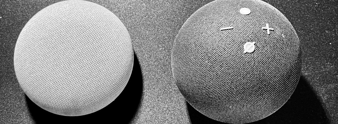 Amazon Echo Dot 4g and Google Mini Nest 3g Black and white photo of the two of them together