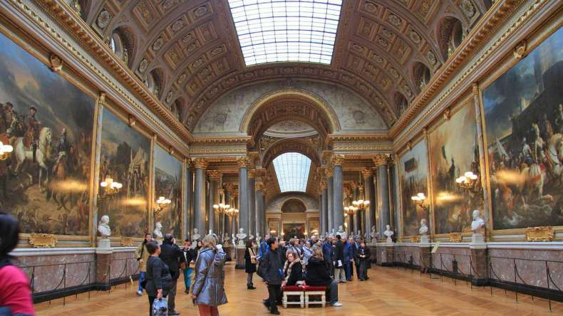 Tourists in a Grand Hall, Louvre Museum