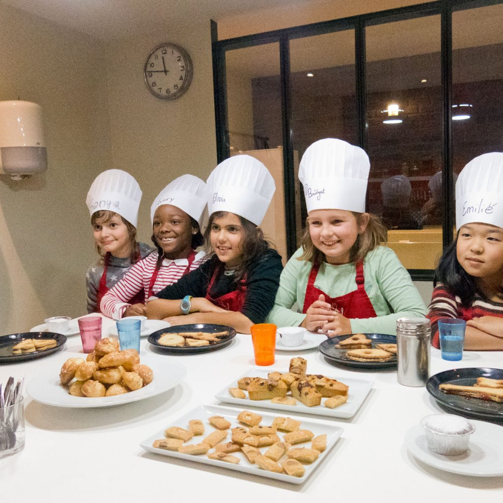 kids are preparing for a cooking class