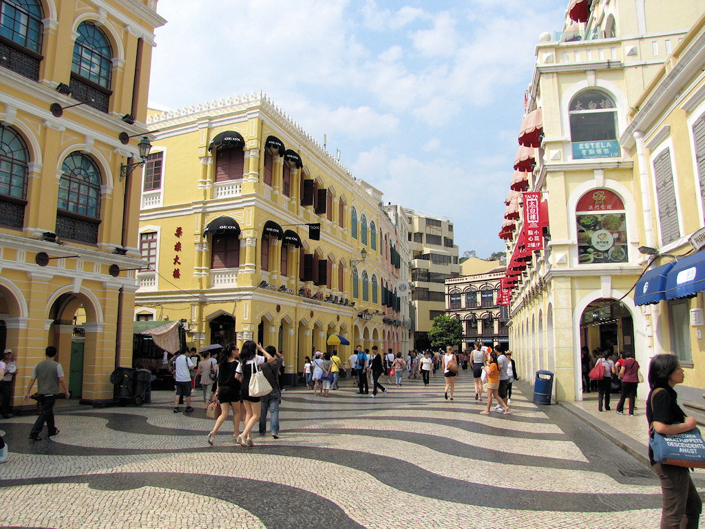 a walking street in st dominic's church in macau with kids