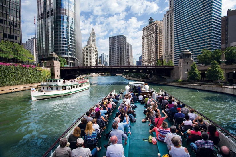passengers are sitting at Architecture Cruise through Chicago River