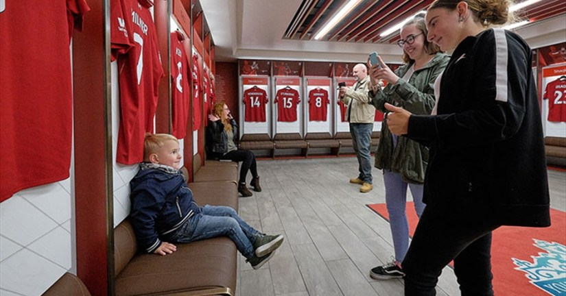 parents take photo for their kids at Liverpool Football Club tour