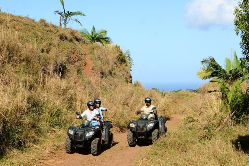 a couple ride a quad bike at Heritage Nature Reserve