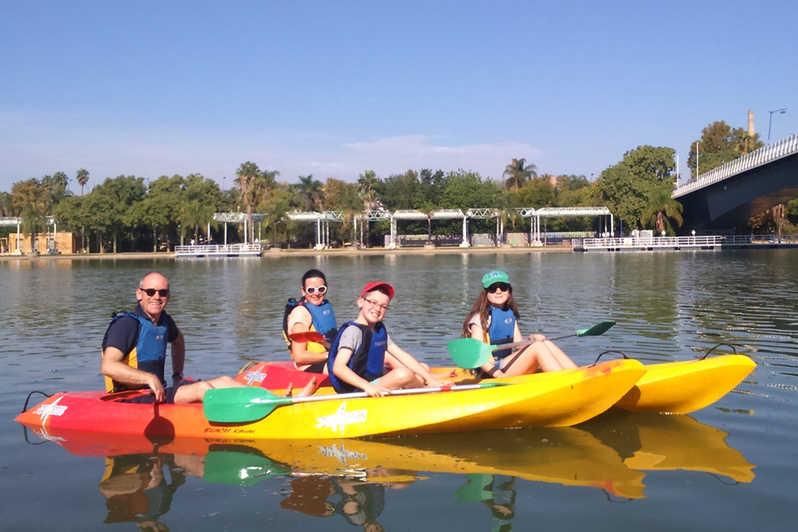 kids and parents play kayak in Seville Guadalquivir River