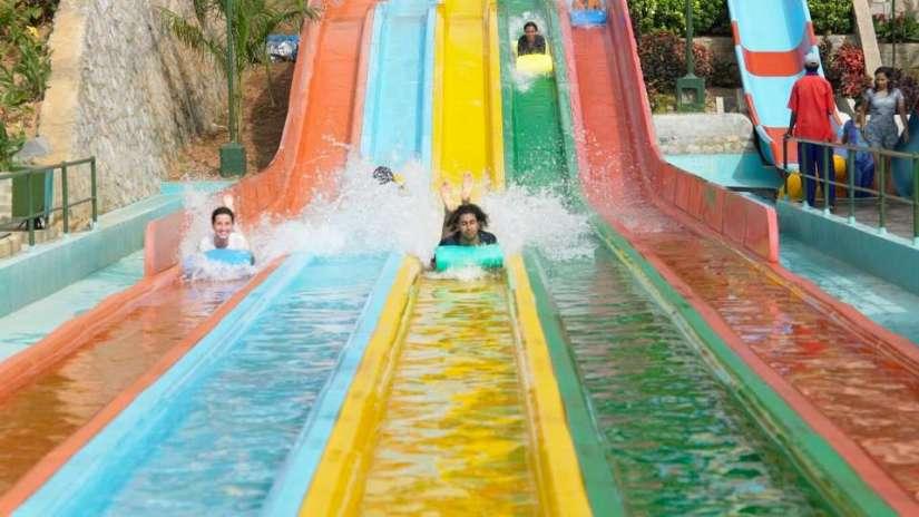 a man slide down at water world water park bangalore