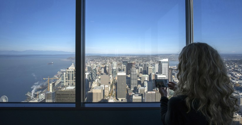 a girl is taking photos in Sky View Observatory at Columbia Tower