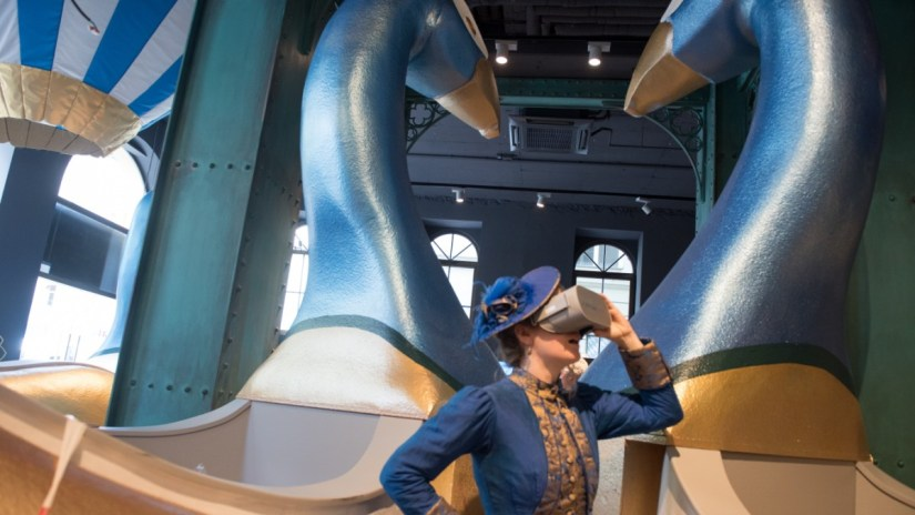 a woman wears VR glasses at VR Journey through Bavarian History