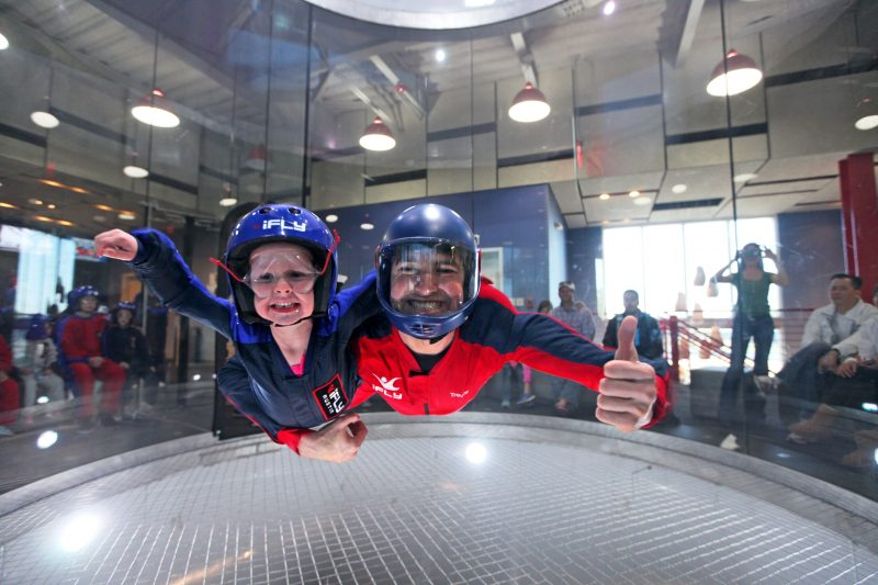 father and daughter are playing iFly indoor in Perth
