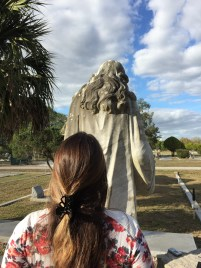 Natalie investigating the difference between traditional Mary hair and the statue's