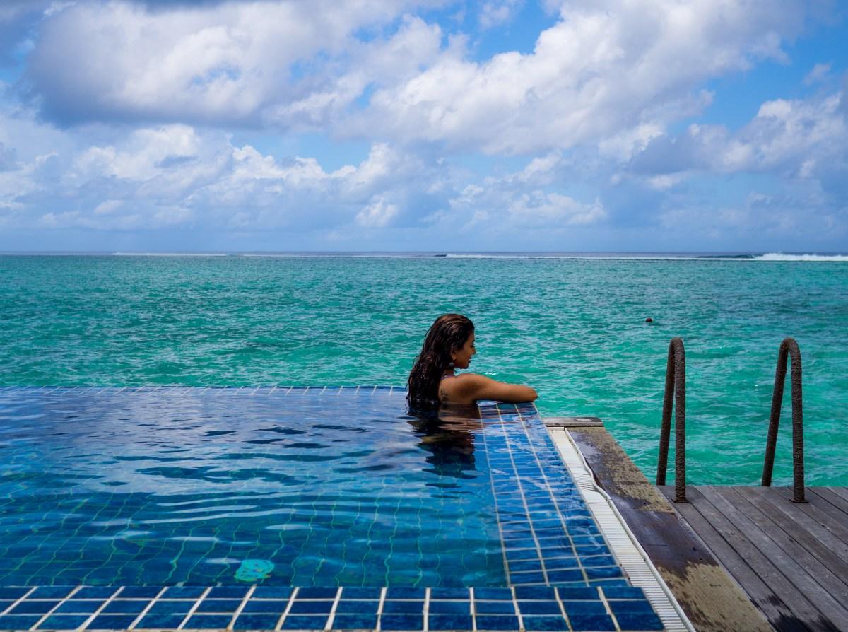 Enjoying the private villa pool overlooking the lagoon - maldives honeymoon