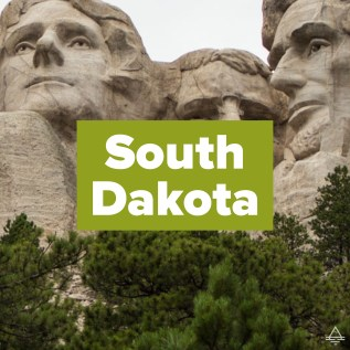 Picture of Mount Rushmore with the words South Dakota on top.