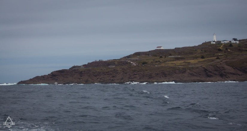 A lighthouse next to the ocean at Cape Spear, Newroundland