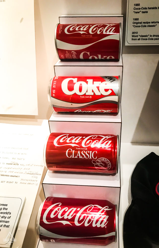 Various Coke Can Designs Including New Coke