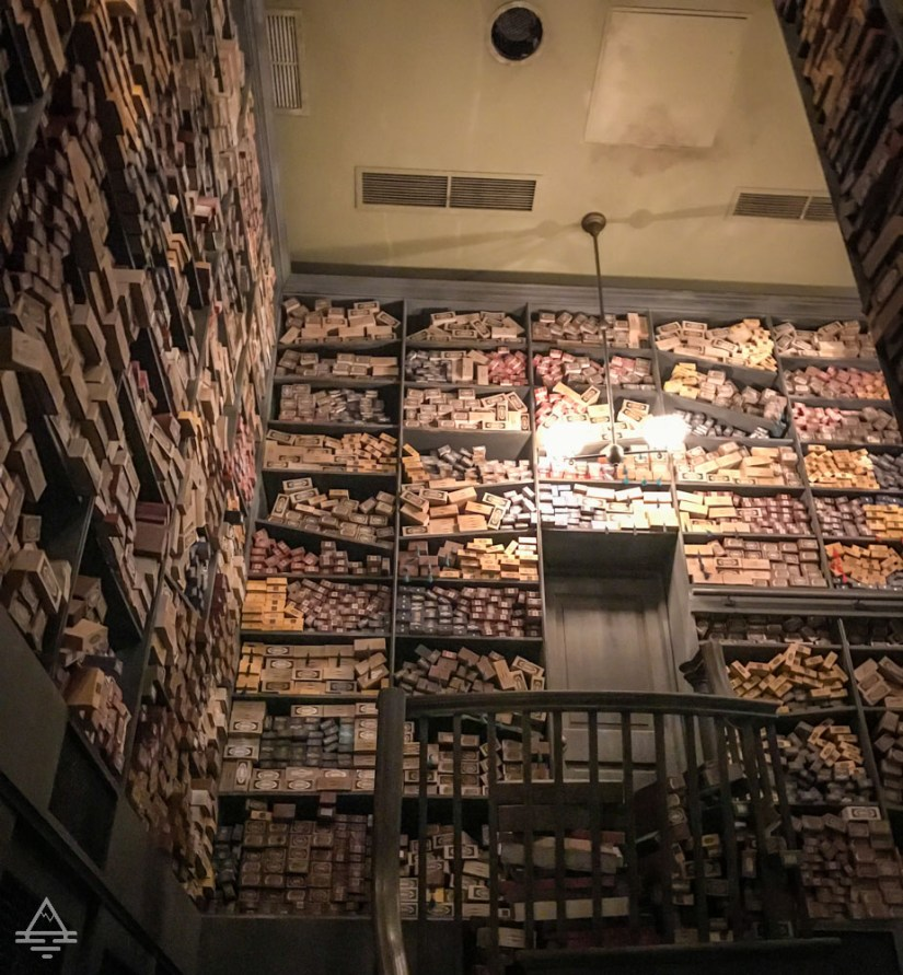 Shelves of wands inside of Olivanders in Harry Potter World in Orlando.